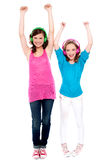 Excited young girls enjoying music together Stock Photo