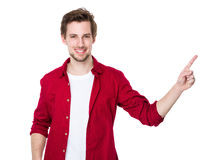 Excited young guy raising his finger Stock Photo