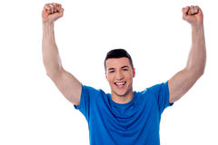 Excited young handsome man Stock Photos