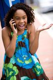 Excited young lady on cellphone Royalty Free Stock Photography