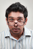 Excited young man. Man wearing spectacle shows an excited face Stock Photo
