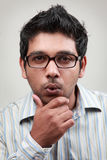 Excited young man. Man wearing spectacle shows an excited face Royalty Free Stock Photo