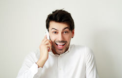 Excited young man calling Stock Photography