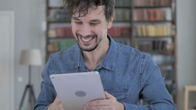 Excited Young Man Celebrating Success, Using Tablet stock footage