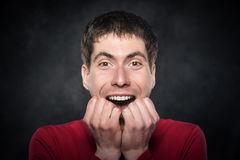 Excited young man. Excited young man on a dark background royalty free stock images