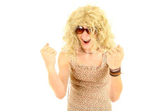 Excited young man dressed as woman Stock Photo