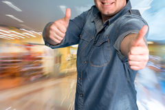 Excited young man gesturing thumbs up Stock Images