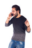 Excited young man. Happy excited beard successful young man making a call, guy wearing gray t-shirt and jeans, isolated on white background Stock Images