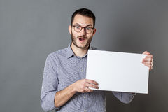 Excited young man holding a copy space banner Stock Photos