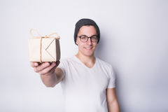 Excited young man holding present isolated on white background Stock Photography