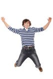 Excited young man jumping in air Stock Image