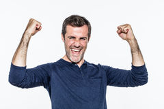Excited young man laughing and shouting for success and satisfaction Royalty Free Stock Photo