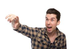 Excited young man pointing finger Royalty Free Stock Photo