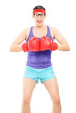Excited young man posing with boxing gloves Royalty Free Stock Image