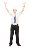 Excited young man with raised hands Royalty Free Stock Images