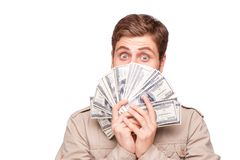 Excited young man with soft money. Cheerful young man holding soft money, isolated on white background Stock Photo