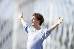 Excited Young Man Stretching out his Arm in Emotion Royalty Free Stock Photo