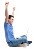 Excited young man using laptop. Young man over white background Royalty Free Stock Photo