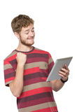 Excited young man using tablet pc Royalty Free Stock Image