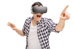 Excited young man using a VR headset Stock Photos