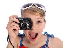 Excited young photographer girl taking pictures Stock Photos