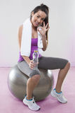 Excited young Pilates girl relaxing with water after the work out Royalty Free Stock Photos