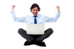Excited young professional with laptop Royalty Free Stock Images