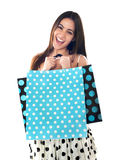 Excited young shopaholic woman posing Stock Photo