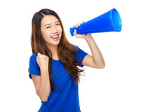 Excited Young student shout with loud speaker Royalty Free Stock Images