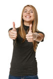 Excited young success woman giving thumbs up Royalty Free Stock Photography