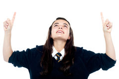 Excited young teenage girl looking upwards Royalty Free Stock Photo