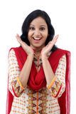 Excited young woman against white background. Excited young Indian woman against white background Stock Image