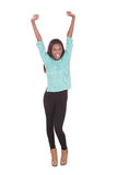 Excited young woman with arms raised Stock Images