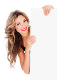Excited young woman with a blank billboard Royalty Free Stock Photography