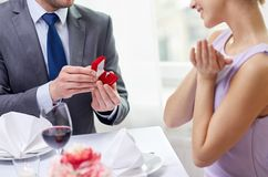 Excited young woman and boyfriend giving her ring Royalty Free Stock Photos