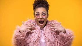 Excited young woman on bright background, fashion trends, millennial glamour royalty free stock image
