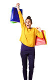 Excited young woman carrying shopping bags Stock Photos