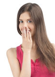Excited young woman covering her mouth Stock Image