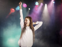 Excited young woman dancing in nightclub Royalty Free Stock Images