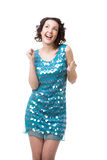 Excited young woman dancing in short sparkling blue dress. Slender young female in short sparkling blue dress, having fun, dreaming, clubbing, dancing disco royalty free stock photo