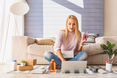 Excited young woman doing online shopping Stock Image