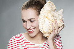 Excited young woman enjoying dreaming about her next holiday Royalty Free Stock Photography