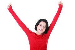 Excited young woman with fists up Stock Images