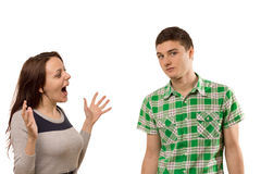 Excited young woman gesturing at her boyfriend Royalty Free Stock Image