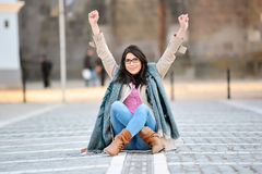 Excited young woman with hands in air Royalty Free Stock Photos