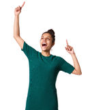 Excited young woman with hands raised in celebration Stock Photos