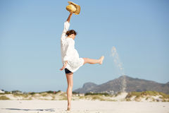 Excited young woman having fun on the beach Royalty Free Stock Image