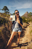 Excited young woman hiker showing a map Royalty Free Stock Images