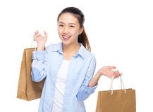 Excited young woman hold shopping bag Royalty Free Stock Photos