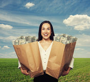 Excited young woman holding bag Royalty Free Stock Photo